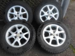 Продам зимнюю шипованную резину Dunlop 17570 на 14 литье. 4x100.00 ET-35 ЦО 63,3мм.