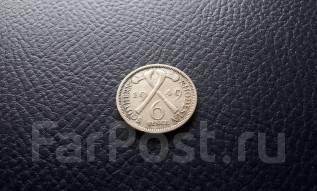 Южная Родезия. Нечастые 6 пенсов 1949 года. Георг VI. Скрещенные топор