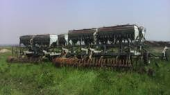 Кировец К-701. Продается трактор К-701, плуг, борон, сеялка ОБЬ-4