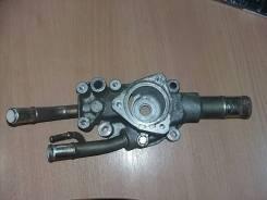 Корпус термостата 1.6 литра 1304995F0B Nissan Almera Classic (B10)