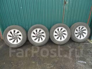 Литьё Escudo с жирной зимней резиной 215/65/R16 Bridgestone 2013 года. 6.0x16 5x139.70 ET25 ЦО 108,0мм.