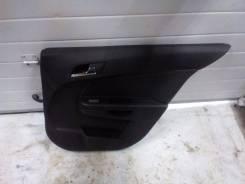 Обшивка двери. Opel Astra