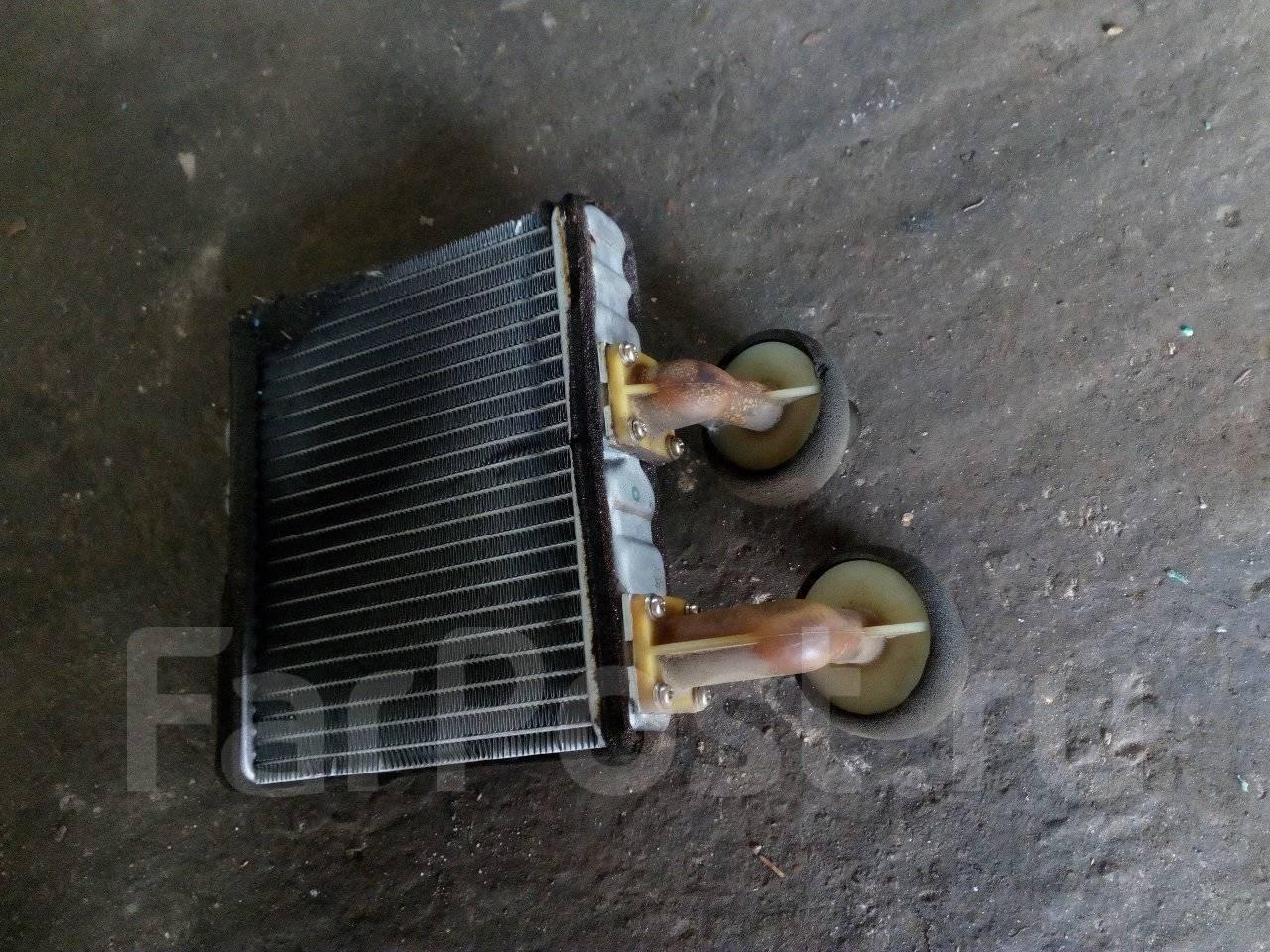 радиатор печьной на митсубиси мираж фото