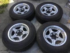 235/70R16 Bridgestone A/T на литье Rays. (16525R). 8.0x16 6x139.70 ET0 ЦО 110,0мм.