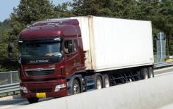 Услуги тягача контейнеровоза, перевозка грузов в контейнере open top