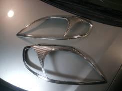 Накладка на фару. Toyota Corolla Fielder Toyota Corolla