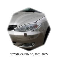 Накладка на фару. Toyota Camry, ACV30, ACV30L, ACV31, ACV35, MCV20, MCV21, MCV30, MCV30L, SXV20, SXV25 Двигатели: 1AZFE, 1MZFE, 2AZFE, 2MZFE, 3MZFE, 5...