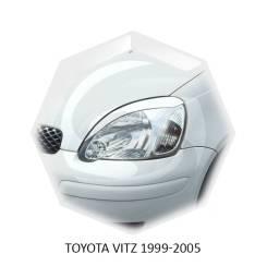 Накладка на фару. Toyota Vitz, NCP15, NCP13, SCP10, SCP13, NCP10 Двигатели: 2NZFE, 1NZFE, 1SZFE, 2SZFE