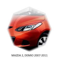 Накладка на фару. Mazda Demio, DW5W, DE3AS, GW5W, DE5FS, DW3W, DE3FS Mazda Mazda2 Двигатели: ZJVEM, ZJVE, ZYVE, B3E, B5E