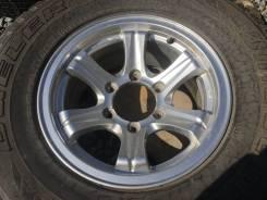 На Запаску одно колесо литой диск +шина Bridgestone Dueler A/T. 7.0x15 6x139.70 ET5 ЦО 110,0мм.