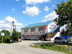 Здание с действующими магазинами и аптекой. Улица Черняховского 20, р-н Новолитовск, 394 кв.м. Дом снаружи