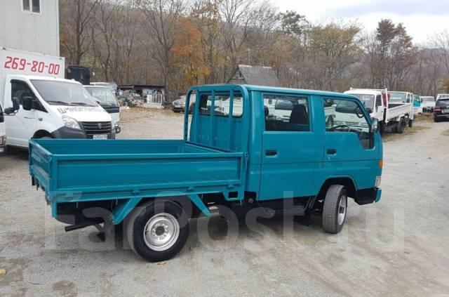 Toyota Dyna. 4WD, двухкабинник+ борт, 3 000 куб. см., 1 500 кг.