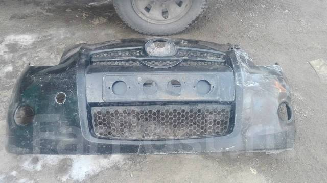 Бампер. Toyota Vitz, SCP90