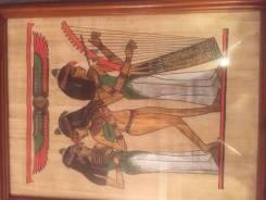 Картина рисованная на папирусе в рамке.