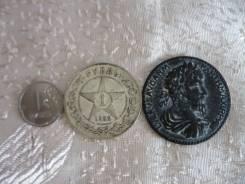 Монета квадрига .