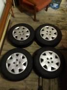 Продам комплект зимних шипованых колес r14 195/70 4 x100. 5.5x14 4x100.00 ET40 ЦО 56,6мм.
