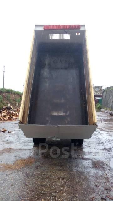Isuzu Elf. самосвал, 4 600 куб. см., 3 300 кг.