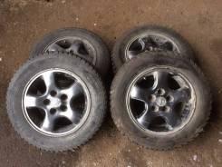 Колеса Nissan на зимней шипованной резине 195/65R15