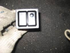 Кнопка открывания бензобака.