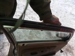 Уплотнитель двери багажника. Mazda Demio