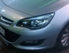 Вставыш в фару на Opel Astra