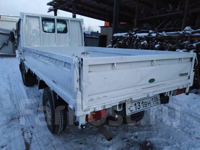 Mazda Titan. , грузовой бортовой, 2 000 куб. см., 1 500 кг.