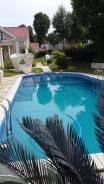 Частный плавательный бассейн с подогревом воды