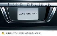 Накладка на дверь багажника. Toyota Land Cruiser, GRJ200, URJ200, URJ202, URJ202W, UZJ200, UZJ200W, VDJ200, J200 1GRFE, 1URFE, 1VDFTV, 2UZFE, 3URFE. П...