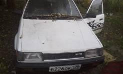 Mazda Familia. механика, передний, бензин