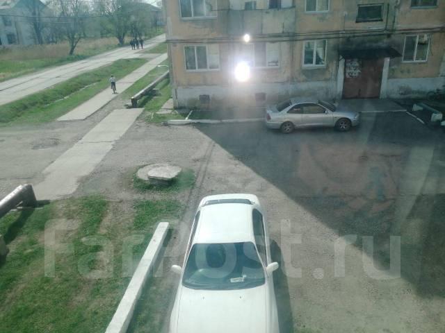 4-комнатная, улица Жуковского (с. Воздвиженка) 1. Воздвиженка, агентство, 61кв.м. Вид из окна днём