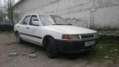 Mazda Familia. механика, передний, 1.3, бензин