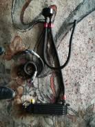 Универсальный спортивный маслорадиатор охлаждения двигателя.