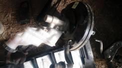 Вакуумный усилитель тормозов.