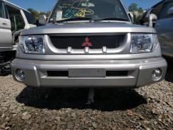 Планка под фары. Mitsubishi Pajero, H65W, H66W, H76W Mitsubishi Pajero iO, H61W, H65W, H66W, H71W, H76W Mitsubishi Montero, H65W, H66W, H76W Двигатели...