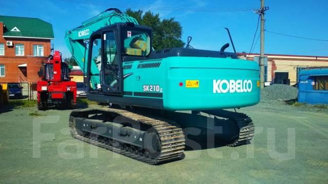 Kobelco SK210LC. Экскаватор , 1,00куб. м.