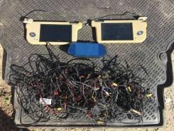 Мониторы в солнцезащитных козырьках и центральный монитор на зеркало