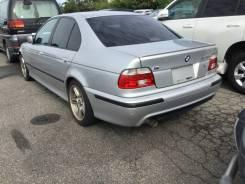 BMW. WBADT62000CE64056
