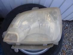Фара передняя левая Daihatsu Mira L250