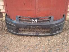 Продам передний бампер Mazda Familia