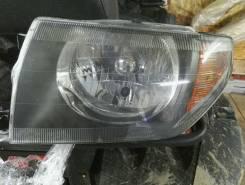 Фара. Mitsubishi Pajero iO