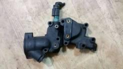 Корпус термостата. Citroen C3, F, HB Peugeot 206, 2A, 2B, 2E/K, 2A/C Двигатели: DV4TD, ET3J4, TU1JP, TU3A, TU3JP