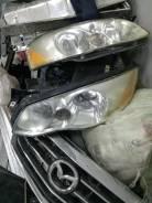 Фара Mazda millenia