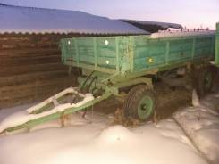 ЛТЗ Т-40. Продам трактор Т-40 2 телеги плуг и имеется бочка под воду, 60 л.с.