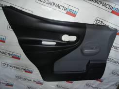 Обшивка двери передней левой Nissan NV200 VM20