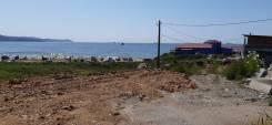 Продаю земельный участок в п. Врангель. 1 500кв.м., аренда, электричество, вода. Фото участка