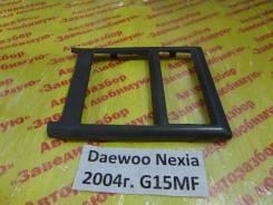 Консоль вокруг магнитолы Daewoo Nexia T100 Daewoo Nexia T100 2004