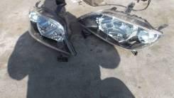 Фара левая P1919 Mazda Demio 2002-2004