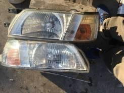 Фара левая Nissan Blueberd 100-63414 100-63770