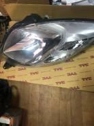 Фара Toyota VITZ/Yaris 05-08 TG21211L2R