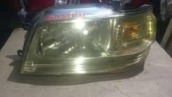 Фара левая Nissan CUBE 12,100-63613